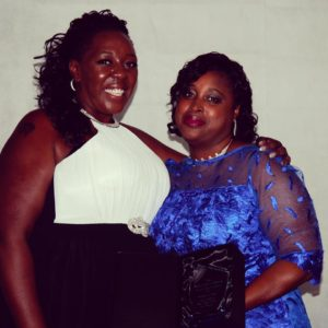 Natasha Bryan with the Female Young Achiever Sidione Mcleod
